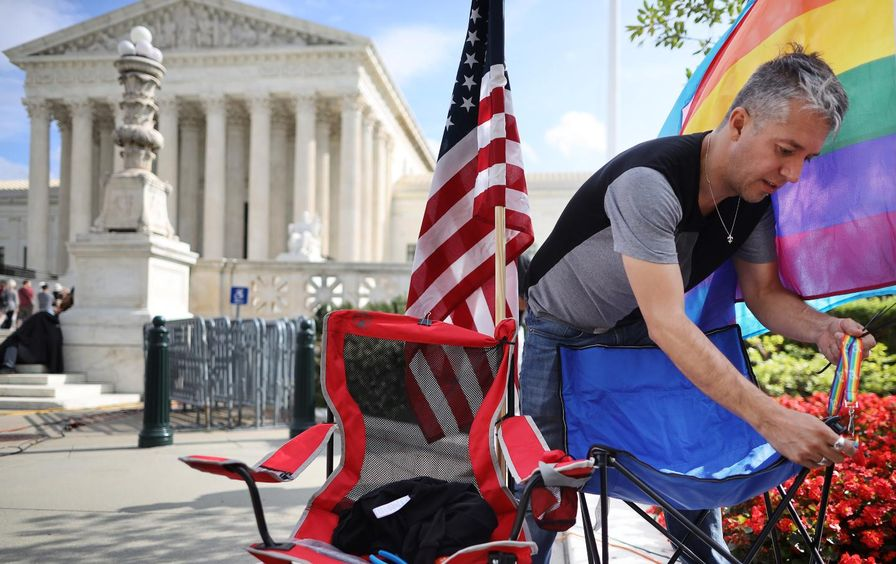 A man outside the Supreme Court building in D.C.
