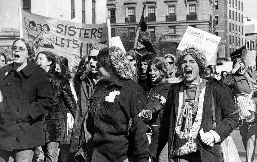 Women marching with signs