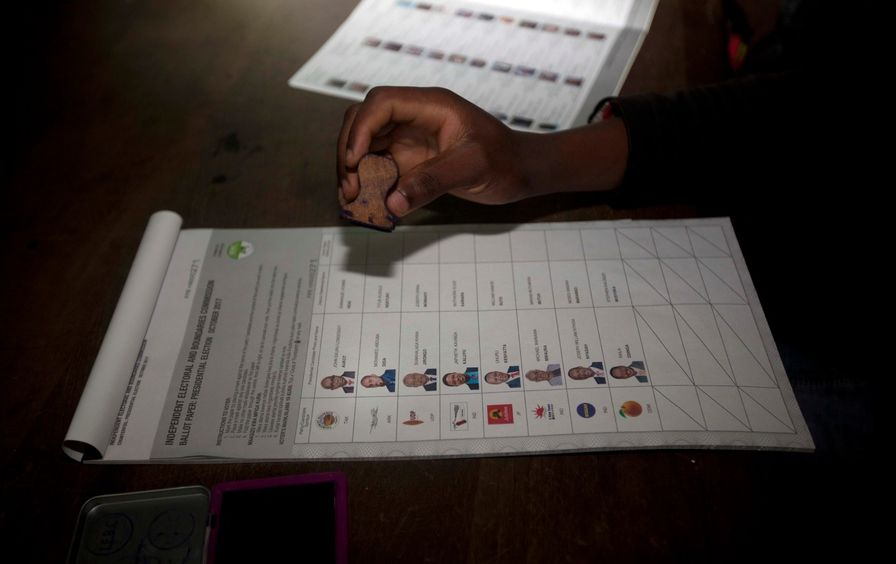 A man stamps a ballot for Kenya's elections
