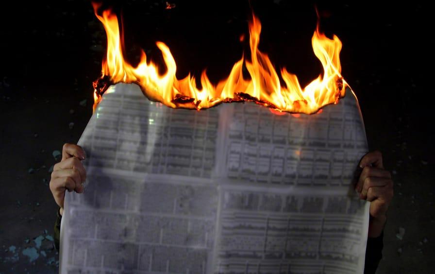 newspaper-fire-burning-ss-img