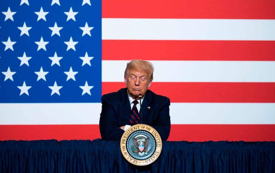 trump-american-flag-arms-crossed-gty-img