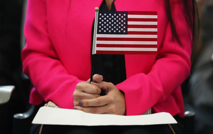 immigration-us-flag-woman-gty-img