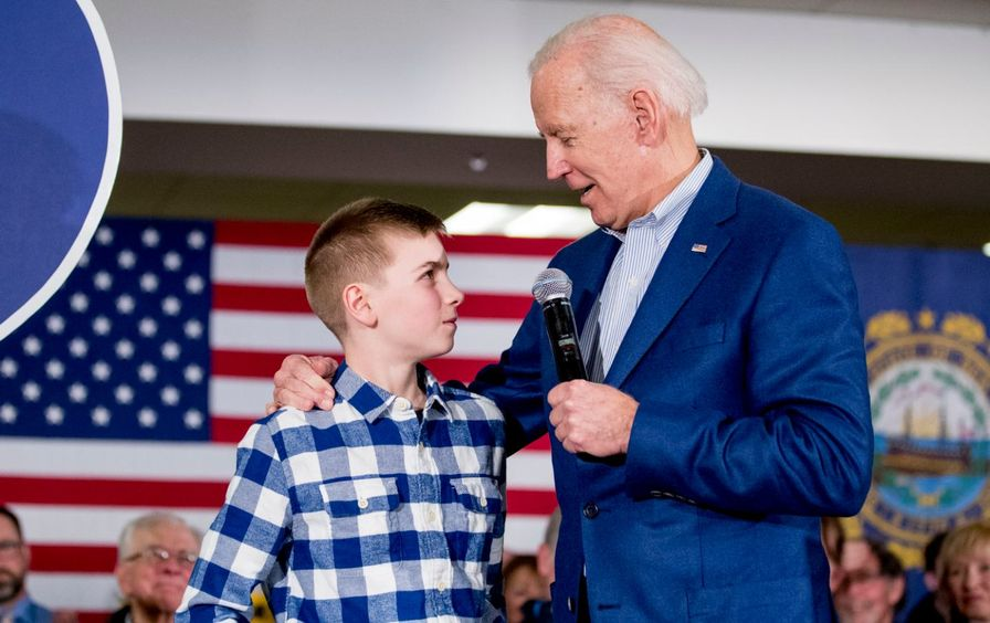 12 year-old Brayden Harrington stands on stage with Joe Biden at a campaign rally