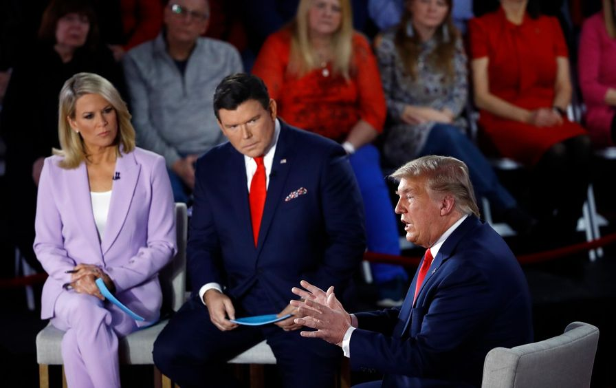 Donald Trump sitting next to two Fox News anchors.