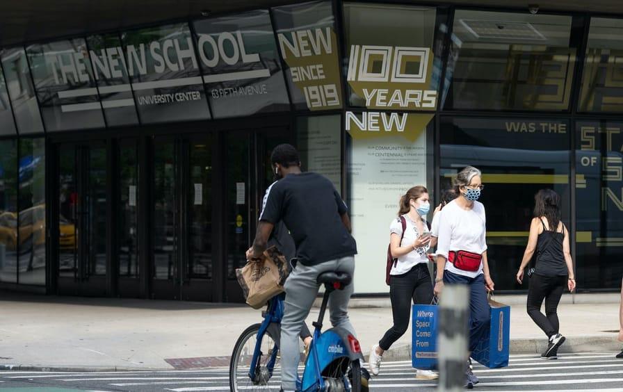 People walking past the New School