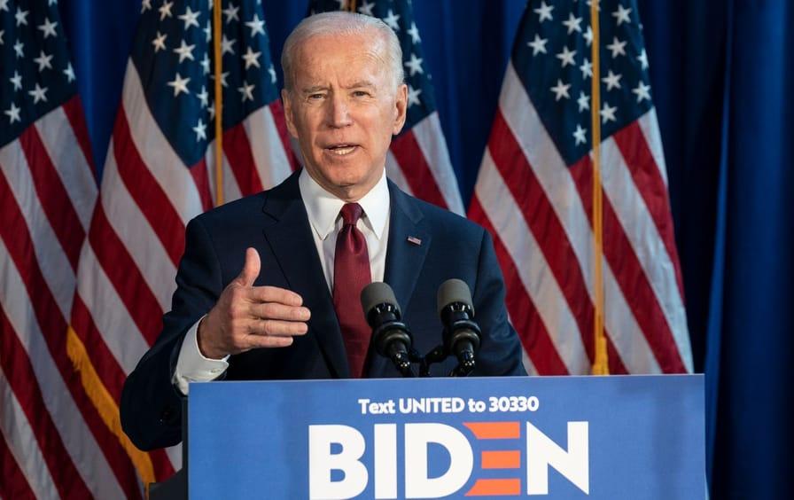 Joe Biden speaking in front of a lectern