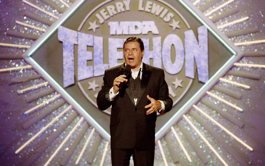 Jerry Lewis holding a microphone