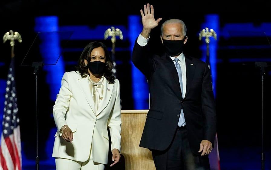 Joe Biden and Kamala Harris wave to the crowd