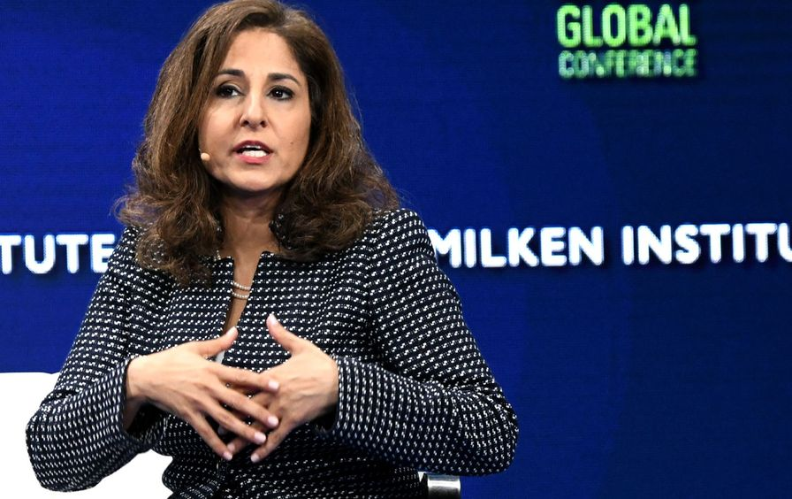 Neera Tanden speaks on stage at the Milken Conference