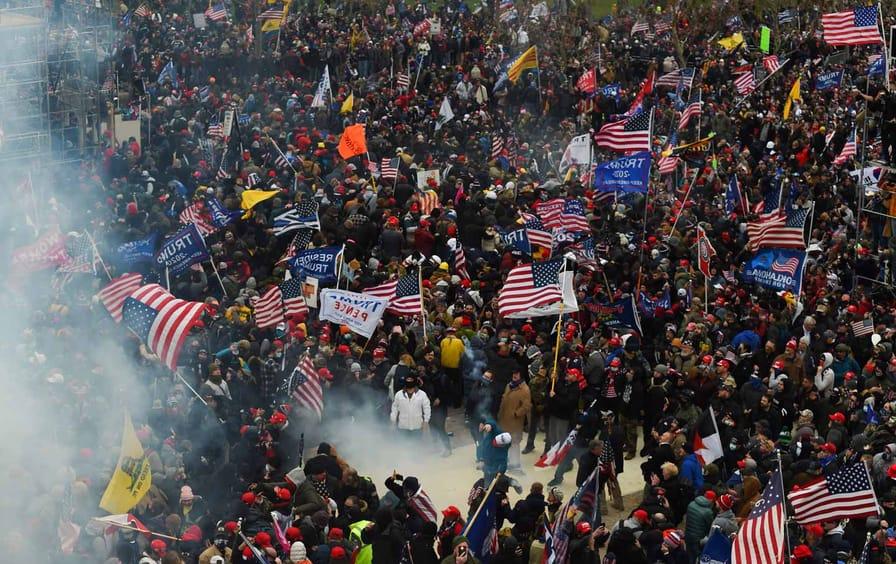 capitol-insurrection-tear-gas-crowd-gty-img