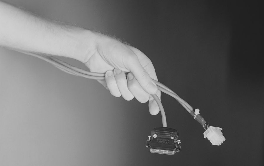 Man holding computer cable, close-up