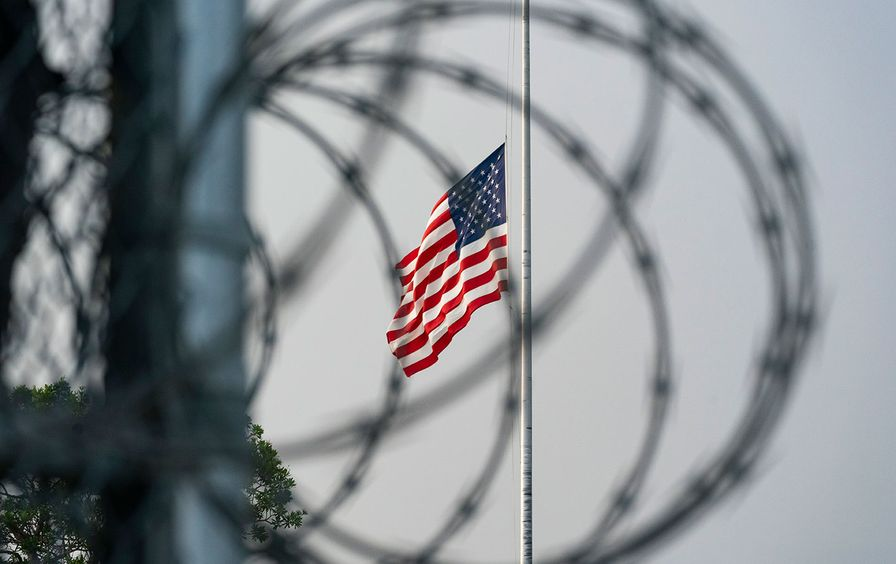 The American flag behind barbed wire