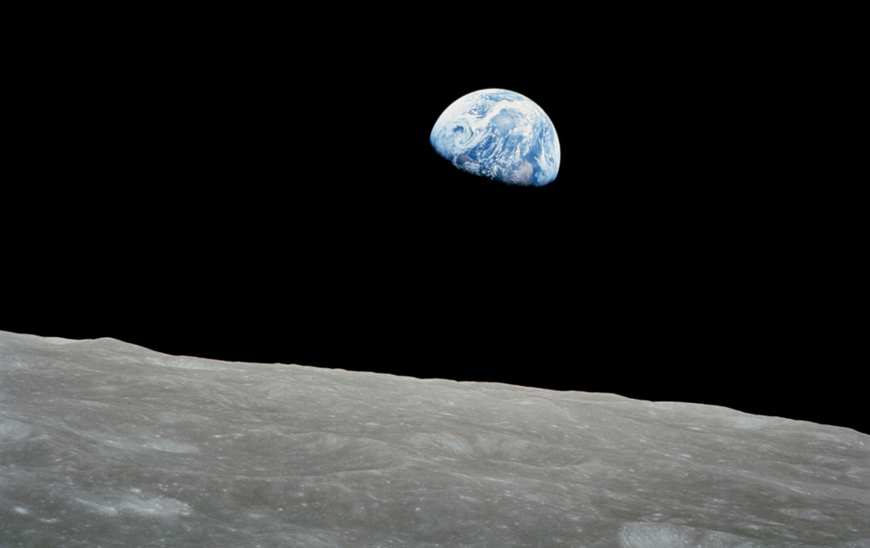Earth rising on the lunar horizon