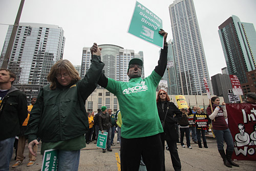 Members of IBEW Local 21, Donna Couch, left, of Steger, Ill., and Abram Hackman of Chicago, both administrative assistants, pray and cheer at the Showdown.Images by David Barreda.