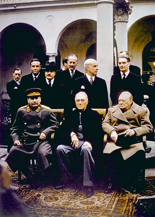 The Yalta Conference, (seated) Joseph Stalin, Franklin D. Roosevelt, Winston Churchill. I.F. Stone reports in The Nation that the agreement reached by the three allied powers leaves many feeling optimistic that a lasting peace can be formed in the aftermath of WWII.  [Everett Collection]