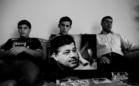 In July 2007, a US Apache helicopter opened fire on a Baghdad street, killing 12 people, including two Reuters employees, one of whom was Saeed Chmagh. At the time of the shooting, the pilots said they believed them to be insurgents. Chmagh's family, including a brother (right) and two sons, is still waiting for an apology.  Credit: Samer Muscati/Human Rights Watch