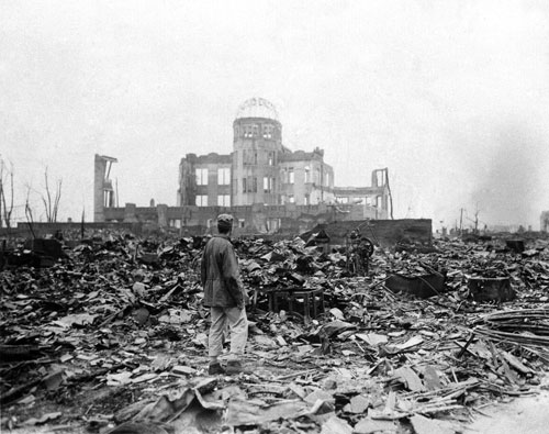 The first atomic bomb is dropped on Hiroshima ending the war in the Pacific and signaling the dawn of the nuclear age and the threat of mutually assured destruction.  [AP Photos/Stanley Troutman]