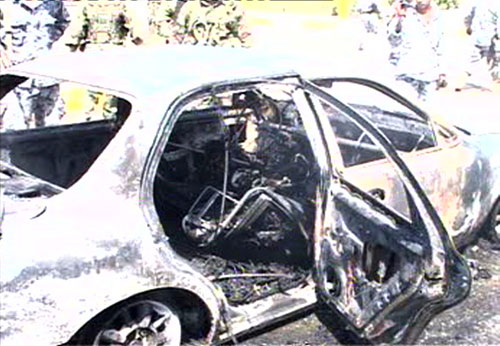 """A still image from a video filmed shortly after the Blackwater armored cars departed Nisour Square. It shows the vehicle of Ahmed and Mahassin Al Rubia'y, the first victims in the square that day. """"There was absolutely no shooting at the Blackwater men,"""" Mohammed says. """"All of a sudden, they started shooting in all directions and they shot at everyone in front of them. There was nothing left in that street that wasn't shot: the ground, cars, poles, sidewalks, they shot everything in front of them."""""""