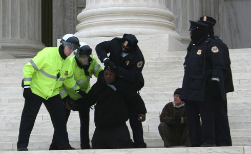 Several protesters were arrested at Occupy the Courts for violating federal law barring political action on Court grounds.