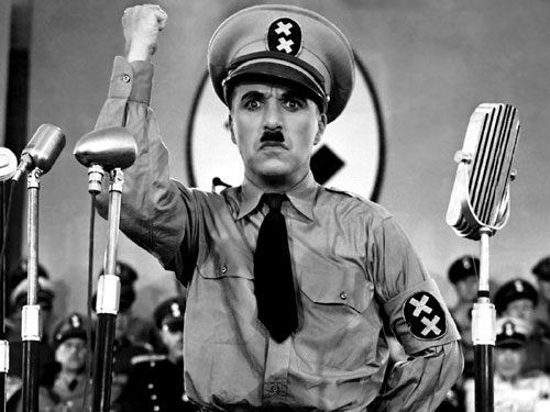 The Great Dictator (1940) Charlie Chaplin takes the bold step of condemning the emerging menace of Adolf Hitler in this, his first talking picture. While the film is a commercial success, few Americans recognize what the future holds. (Photo: Everett Collection)