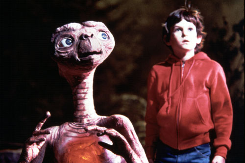 E.T.: The Extra-Terrestrial (1982) Steven Spielberg conceives this touching story of a young boy (played by Henry Thomas, pictured) who befriends a cuddly alien as a small personal project to follow up the elaborate Indiana Jones films and winds up with the biggest hit movie of the decade. No small feat during the worst economic downturn since the Great Depression.[Everett Collection]