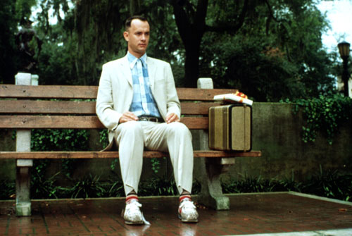 "Forrest Gump (1994) Tom Hanks wins his second straight Best Actor Oscar for his portrayal of an amiable simpleton who manages to make cameo appearances in virtually every major event of the latter twentieth century. Gump's cheerful catchphrases, such as  ""Life is like a box of chocolates..."" become cemented in the 1990s pop culture lexicon.[Everett Collection]"