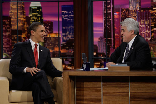 "Obama becomes the first sitting president to appear on a late-night talk show when he joins Jay Leno on The Tonight Show. Some of his remarks (comparing DC to American Idol, ""except everyone is Simon Cowell"") are charming, while others (a poorly executed Special Olympics reference) fall flat. (AP Photos)"