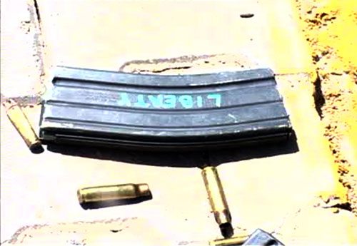 """An empty gun magazine found at the square after the shooting with the word """"Liberty"""" written on it. One of the defendants in Mohammed's case is Evan Liberty, one of the alleged Blackwater shooters that day."""