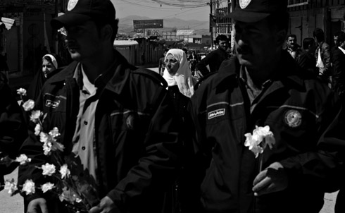 Police with flowers from protesters