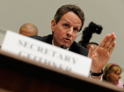 "After months of stalling, Geithner finally unveils his ""bank rescue"" plan, which allows private investors to buy up toxic assets without fundamentally changing our current market system. It's very well received by Wall Street, but critics on the left are so disappointed that  they begin calling for his resignation.(AP Images)"