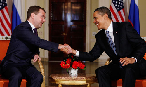 On his first international trip as president, Obama meets with Russia's Dimitry Medvedev at the G-20 summit in London. The two leaders agree to launch negotiations for a new arms control treaty that could slash strategic nuclear arsenals by a third. Still, Obama won't commit to the goal of a world without nuclear weapons in his lifetime. (AP Images)