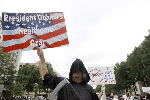 """As soon Democrats as unveil their plans to reform healthcare the far right fringe makes its presence felt at town hall meetings, in Washington and all over the cable news landscape. Peddling lies and using fear tactics, these extremists help to create myths (such as """"death panels"""" which can order the expiration of your loved ones) that endure in some conservative circles to this day. [AP Images]"""