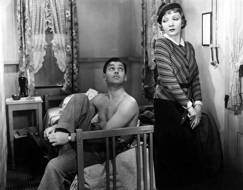 "The first film to win all five major Academy Awards (Best Picture, Director, Actor, Actress and Screenplay), Frank Capra's screwball comedy causes a sensation with its ribald humor and the presence of a shirtless Clark Gable (pictured with co-star Claudette Colbert). The Nation's William Troy is charmed, describing the film as ""exceptionally well put together from almost every point of view."" (Photo: Everett Collection)"