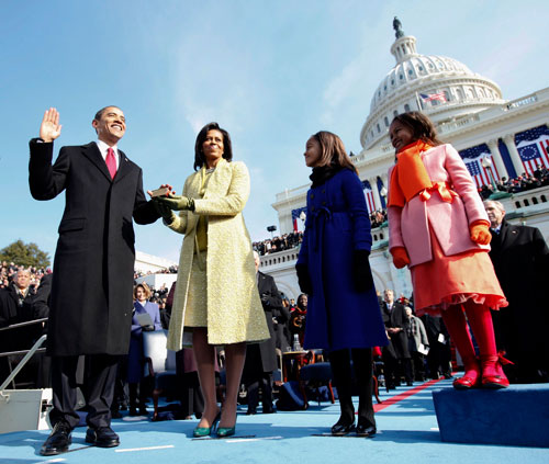 Barack Obama is sworn in as the forty-fourth president of the United States. The largest crowd ever on record attends the ceremony, and he begins his term with unprecedented high approval ratings.(AP Images)