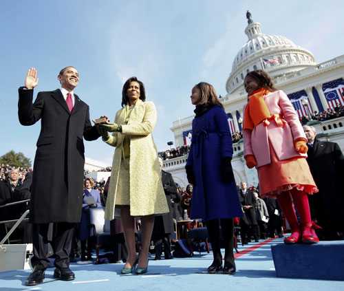 """In January, following the previous November's historic election, Barack Obama is sworn in as the forty-fourth president of the United States in front of a record breaking crowd in the nation's capital. In a somber speech, Obama says, """"The challenges we face are real. They are serious and they are many. They will not be met easily or in a short span of time. But know this, America: They will be met.""""AP Images"""