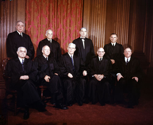 "As President Obama searches for a replacement for Justice David Souter, he should seek a person of extraordinary intelligence, integrity and moral vision. Legendary Justices Earl Warren (seated, center), Hugo Black (left of Warren) and William O. Douglas (seated, end of the row) are among the models cited in The Nation's May 6 forum, ""Following Souter.""  [AP Images]"