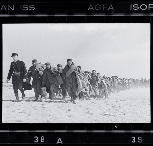 Exiled Republicans being marched down the beach to an internment camp, Le Barcarès, France, March 1939