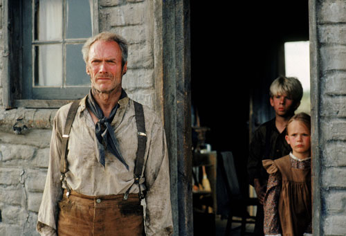 "Clint Eastwood's coming-out party as a critical darling is viewed by many observers as a mea culpa for the numerous unrepentantly violent films he had made over the years. The Nation's Stuart Klawans goes further, suggesting the revisionist western is at best a reflection of America, albeit an America that ""is a drunk who can't stay on the wagon."" (Photo: Everett Collection)"