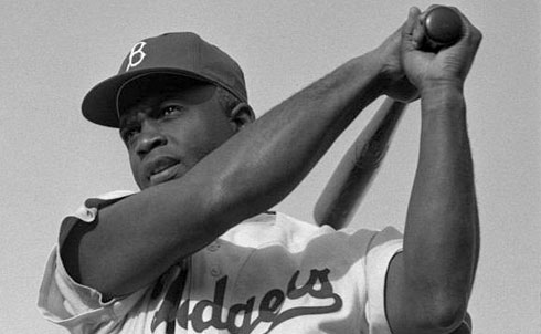 "A four-sport athletic star in high school in Pasadena and then at the University of California, Los Angeles, Robinson played in the Negro Leagues before becoming the first African-American to play in the major leagues, in 1947. He endured physical and verbal abuse on and off the field, showing remarkable courage, while helping pave the way for the civil rights movement. Martin Luther King Jr. said to Don Newcombe, Robinson's teammate, ""You, Jackie and Roy [Campanella] will never know how easy you made it for me to do my job."" During World War II Robinson faced a court-martial for refusing to move on a segregated bus outside a military base in Texas. As Rookie of the Year in 1947, Most Valuable Player in 1949 and a six-time All-Star, he led the Brooklyn Dodgers to several pennants. During and after his playing days, he joined picket lines and marches, wrote a newspaper column that attacked racism and raised funds for the NAACP. In testimony before Congress while still a player, he condemned America's racism but also criticized Paul Robeson's radicalism, a remark he later said he regretted.   Further Reading: I Never Had It Made: The Autobiography of Jackie Robinson. Jackie Robinson: A Biography by Arnold Rampersad. Baseball's Great Experiment: Jackie Robinson and His Legacy by Jules Tygiel.   Credit: Look magazine photograph collection (Library of Congress)"