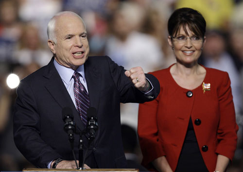 "However, in a move to shake up his campaign and to woo disgruntled Hillary Clinton supporters, Republican presidential nominee John McCain selects Palin as his vice presidential running mate on August 29, 2008. Branding themselves a team of ""mavericks"" the unlikely ticket is deemed both bold and risky at a time of war and economic collapse.  [AP Image]"