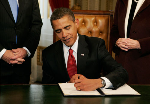 Obama hits the ground running with a series of executive orders, including a halt to all last-minute Bush-authorized regulations, comprehensive ethics rules to crack down on lobbyists, and expansion of the federal government's transparency. (Reuters Pictures)