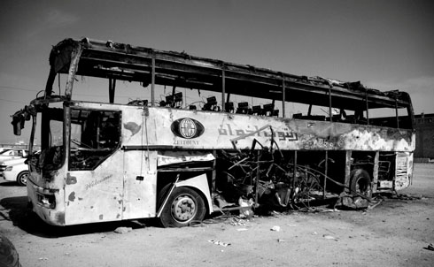 The car bomb that destroyed this bus exploded near the Imam Ali shrine in Najaf during Iraq's national parliamentary elections, killing three pilgrims and wounding 50. Terrorists in Iraq frequently time their attacks, such as vehicle and suicide bombs, to maximize civilian causalities.  Credit: Samer Muscati/Human Rights Watch