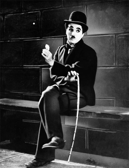 City Lights (1931) Charlie Chaplin's determined Little Tramp is the perfect hero for hard times. This sweet tale of romance with a blind girl who mistakes him for a millionaire is poignant and profound. Many, including Chaplin himself, consider it his greatest masterpiece. (Photo: AP Images)