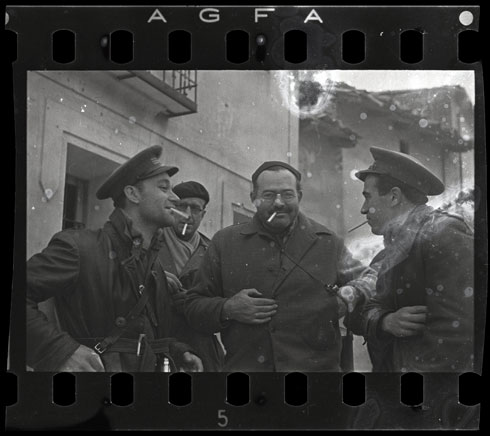 [Ernest Hemingway (third from the left), New York Times journalist Herbert Matthews (second from the left) and two Republican soldiers, Teruel, Spain], late December 1937
