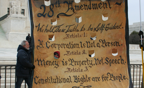 A Move to Amend banner was on hand to advocate for a 28th Amendment:  We hold these Truths to be Self-Evident. Article 1: A Corporation is not a Person. Article 2: Money is Property, not Speech. Article 3: Constitutional Rights are for People.  Image credit: Loren Fogel