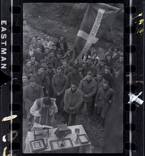 Outdoor mass for Republican soldiers, near Lekeitio, Basque region, Spain, January-February 1937 By Chim (David Seymour)  © Estate of David Seymour / Magnum International Center of Photography