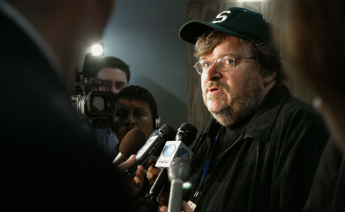 In the tradition of earlier muckraking journalists, Moore has used his biting wit, eye for human foibles, anger at injustice, faith in the common sense of ordinary people and skills as a filmmaker, author and public speaker to draw widespread attention to some of America's most chronic problems. His first film, the low-budget documentary Roger & Me (1989), examined the tragic human consequences of General Motors' decision to close its factory in Flint (Moore's hometown) and export the jobs to Mexico. The Big One (1997) examined corporate America's large-scale layoffs during a period of record profits, focusing on Nike's decision to outsource its shoe production to Indonesia. His documentaries in the twenty-first century have explored America's love affair with guns and violence (the Academy Award–winning Bowling for Columbine), the links between the families of George W. Bush and Osama bin Laden in the aftermath of September 11 (Fahrenheit 9/11), healthcare reform (Sicko) and the financial crisis and the political influence of Wall Street (Capitalism: A Love Story). Moore also directed and hosted two TV news magazine shows—TV Nation (1994–95) and The Awful Truth (1999–2000)—that focused on controversial topics other shows avoided. The author of several books of political satire—including Downsize This! (1996), Stupid White Men (2001) and Dude, Where's My Country? (2003)—Moore is a frequent commentator on TV talk-shows and regularly speaks at rallies and events to help build a movement for economic and social justice.