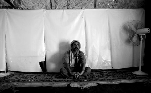 In 2006, the day after his Shiite neighbor was killed and two hours after he and his family were threatened with death for living in a Sunni neighborhood north of Baghdad, Abed Mahsan fled his house with whatever possessions he could carry. Since then, he has lived in a tent lined with plastic election posters to keep water out, and has moved numerous times within Baghdad. Because of his displacement, none of his six children is able to attend school. More than one million Iraqis remain displaced, mainly from the sectarian civil strife that engulfed the country in 2006 and 2007.  Credit: Samer Muscati/Human Rights Watch