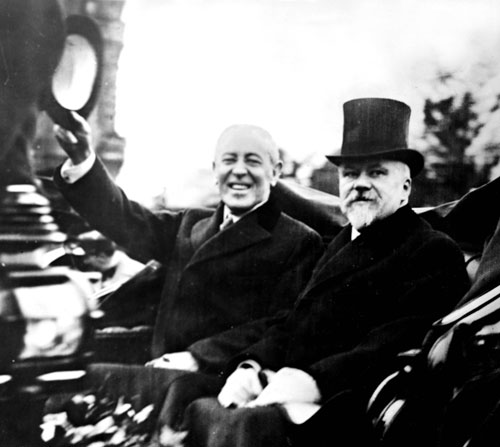 Wilson and French President Raymond Poincaré at the Paris Peace Conference. The Treaty of Versailles brings an end to World War I, but also sets the stage for the rise of Adolf Hitler.[Everett Collection]