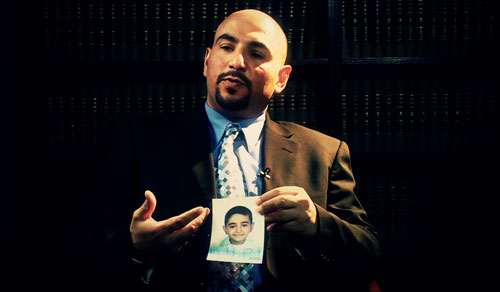 """Mohammed Kinani holds a photo of his son while speaking to The Nation's Jeremy Scahill. """"I wish the US Congress would ask [Erik Prince] why they killed my innocent son. Do you think that this child was a threat to your company?"""" Mohammed asked. """"This giant company that has the biggest weapons, the heaviest weapons, the planes, and this boy was a threat to them?""""Photo: Rick Rowley, BigNoiseFilms.org"""